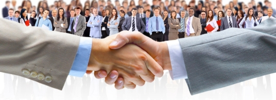 Business-Handshake-With-Crowd-Behind